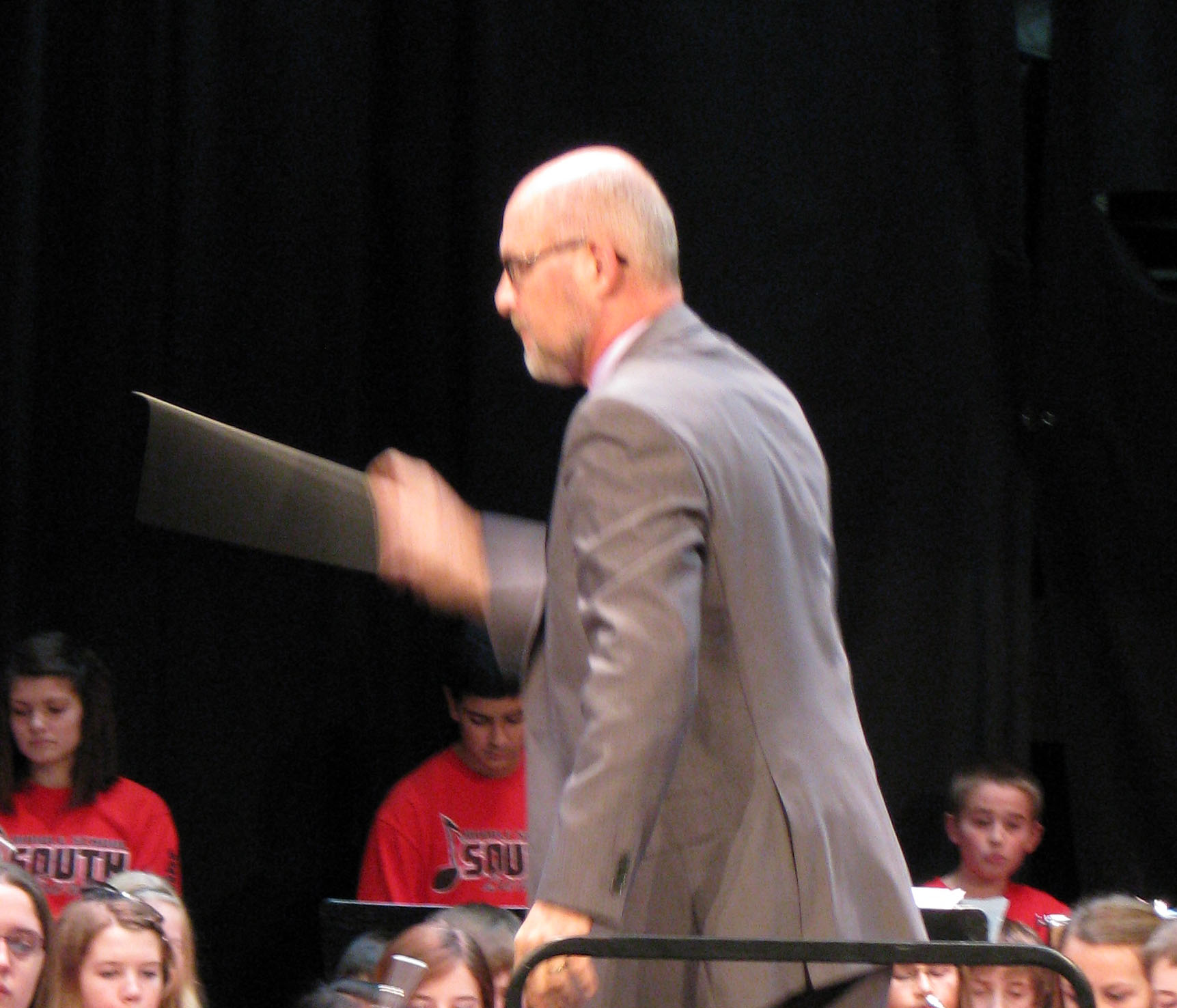 Photo of Bill Simon conducting middle school band